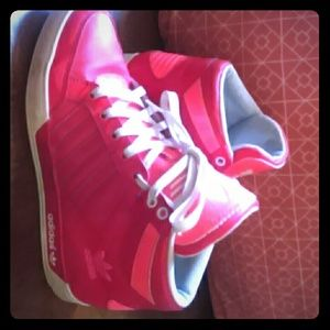 Salmon and red colored adidas